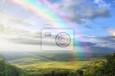 Постер Пейзаж горный Летний пейзаж с радугой зеленые холмы и чистое голубое небоПейзаж горный<br>Постер на холсте или бумаге. Любого нужного вам размера. В раме или без. Подвес в комплекте. Трехслойная надежная упаковка. Доставим в любую точку России. Вам осталось только повесить картину на стену!<br>