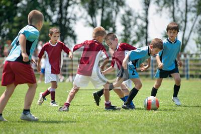 Постер Футбол Дети играли в футбол за пределамиФутбол<br>Постер на холсте или бумаге. Любого нужного вам размера. В раме или без. Подвес в комплекте. Трехслойная надежная упаковка. Доставим в любую точку России. Вам осталось только повесить картину на стену!<br>