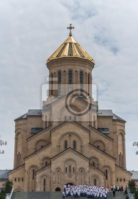 Постер Грузия Кафедральный собор Самеба фасадГрузия<br>Постер на холсте или бумаге. Любого нужного вам размера. В раме или без. Подвес в комплекте. Трехслойная надежная упаковка. Доставим в любую точку России. Вам осталось только повесить картину на стену!<br>
