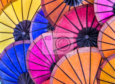 Постер Лаос Разноцветные Зонтики на Ночной Рынок юго - Восточной АзииЛаос<br>Постер на холсте или бумаге. Любого нужного вам размера. В раме или без. Подвес в комплекте. Трехслойная надежная упаковка. Доставим в любую точку России. Вам осталось только повесить картину на стену!<br>