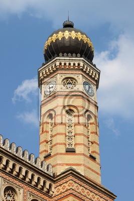 Постер Венгрия Башня Большой Синагоги Будапешта, ВенгрияВенгрия<br>Постер на холсте или бумаге. Любого нужного вам размера. В раме или без. Подвес в комплекте. Трехслойная надежная упаковка. Доставим в любую точку России. Вам осталось только повесить картину на стену!<br>