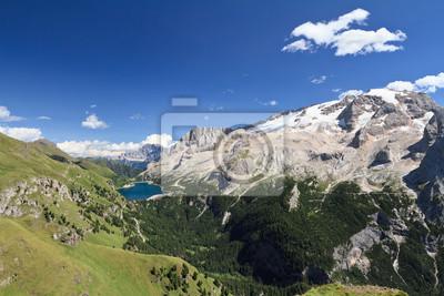 Постер Альпийский пейзаж Fedaia озеро и Горы MarmoladaАльпийский пейзаж<br>Постер на холсте или бумаге. Любого нужного вам размера. В раме или без. Подвес в комплекте. Трехслойная надежная упаковка. Доставим в любую точку России. Вам осталось только повесить картину на стену!<br>