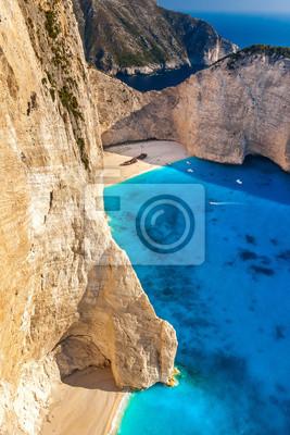Постер Греция Всемирно известный пляж Navagio в Закинтос, ГрецияГреция<br>Постер на холсте или бумаге. Любого нужного вам размера. В раме или без. Подвес в комплекте. Трехслойная надежная упаковка. Доставим в любую точку России. Вам осталось только повесить картину на стену!<br>