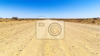 Постер Пейзаж песчаный Дороги пустыниПейзаж песчаный<br>Постер на холсте или бумаге. Любого нужного вам размера. В раме или без. Подвес в комплекте. Трехслойная надежная упаковка. Доставим в любую точку России. Вам осталось только повесить картину на стену!<br>
