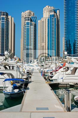 Постер ОАЭ Яхт-Клуб в Dubai Marina, Дубай, ОАЭ.ОАЭ<br>Постер на холсте или бумаге. Любого нужного вам размера. В раме или без. Подвес в комплекте. Трехслойная надежная упаковка. Доставим в любую точку России. Вам осталось только повесить картину на стену!<br>
