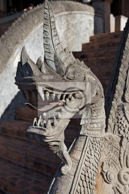 Постер Лаос Детали из камня дракона на Haw Pha Kaeo храм в Вьентьян, ЛаосЛаос<br>Постер на холсте или бумаге. Любого нужного вам размера. В раме или без. Подвес в комплекте. Трехслойная надежная упаковка. Доставим в любую точку России. Вам осталось только повесить картину на стену!<br>