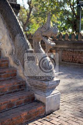 Постер Лаос Каменный дракон на Haw Pha Kaeo храм в Вьентьян, ЛаосЛаос<br>Постер на холсте или бумаге. Любого нужного вам размера. В раме или без. Подвес в комплекте. Трехслойная надежная упаковка. Доставим в любую точку России. Вам осталось только повесить картину на стену!<br>