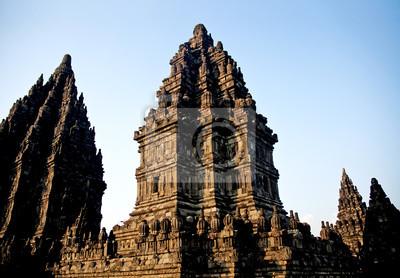 Постер Индонезия Прамбанан храма в ИндонезииИндонезия<br>Постер на холсте или бумаге. Любого нужного вам размера. В раме или без. Подвес в комплекте. Трехслойная надежная упаковка. Доставим в любую точку России. Вам осталось только повесить картину на стену!<br>
