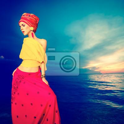 Постер Гламур Чувственная девушка в восточном стиле на пляже на закатеГламур<br>Постер на холсте или бумаге. Любого нужного вам размера. В раме или без. Подвес в комплекте. Трехслойная надежная упаковка. Доставим в любую точку России. Вам осталось только повесить картину на стену!<br>
