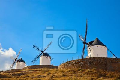 Ветряные мельницы в Consuegra, Испания, 30x20 см, на бумагеМельницы<br>Постер на холсте или бумаге. Любого нужного вам размера. В раме или без. Подвес в комплекте. Трехслойная надежная упаковка. Доставим в любую точку России. Вам осталось только повесить картину на стену!<br>