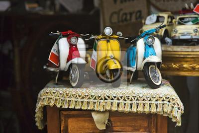 Постер-картина Мотороллеры Крупным планом игрушка скутеры для продажиМотороллеры<br>Постер на холсте или бумаге. Любого нужного вам размера. В раме или без. Подвес в комплекте. Трехслойная надежная упаковка. Доставим в любую точку России. Вам осталось только повесить картину на стену!<br>