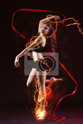Постер Танец Молодая девушка танцует с огнемТанец<br>Постер на холсте или бумаге. Любого нужного вам размера. В раме или без. Подвес в комплекте. Трехслойная надежная упаковка. Доставим в любую точку России. Вам осталось только повесить картину на стену!<br>