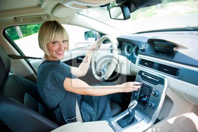 Постер Праздники Привлекательная женщина-водитель на своей машине, 30x20 см, на бумаге10.27 День автомобилиста<br>Постер на холсте или бумаге. Любого нужного вам размера. В раме или без. Подвес в комплекте. Трехслойная надежная упаковка. Доставим в любую точку России. Вам осталось только повесить картину на стену!<br>
