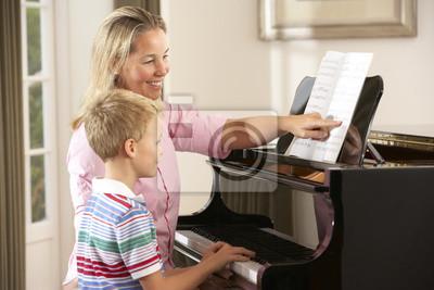 Молодой мальчик на занятии с преподавателем фортепиано, 30x20 см, на бумаге10.05 День учителя России<br>Постер на холсте или бумаге. Любого нужного вам размера. В раме или без. Подвес в комплекте. Трехслойная надежная упаковка. Доставим в любую точку России. Вам осталось только повесить картину на стену!<br>