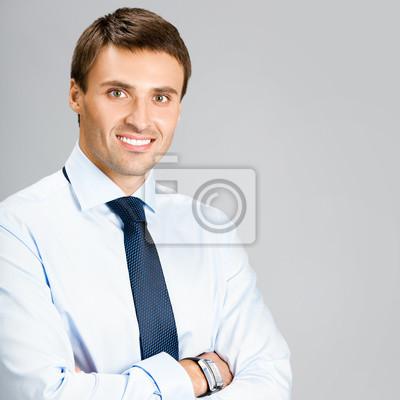 Постер 11.07 Всемирный день мужчин Портрет делового человека, над серый фон11.07 Всемирный день мужчин<br>Постер на холсте или бумаге. Любого нужного вам размера. В раме или без. Подвес в комплекте. Трехслойная надежная упаковка. Доставим в любую точку России. Вам осталось только повесить картину на стену!<br>