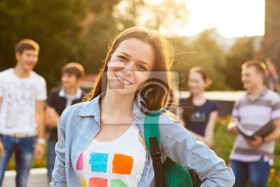 Женщина улыбается студент на открытом воздухе, 30x20 см, на бумаге06.27 День молодёжи России<br>Постер на холсте или бумаге. Любого нужного вам размера. В раме или без. Подвес в комплекте. Трехслойная надежная упаковка. Доставим в любую точку России. Вам осталось только повесить картину на стену!<br>