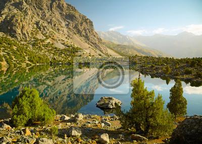 Постер Фанские горы Озеро в Фанские горы, ТаджикистанФанские горы<br>Постер на холсте или бумаге. Любого нужного вам размера. В раме или без. Подвес в комплекте. Трехслойная надежная упаковка. Доставим в любую точку России. Вам осталось только повесить картину на стену!<br>