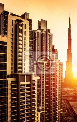 Постер Дубай Дубай центр города в закатеДубай<br>Постер на холсте или бумаге. Любого нужного вам размера. В раме или без. Подвес в комплекте. Трехслойная надежная упаковка. Доставим в любую точку России. Вам осталось только повесить картину на стену!<br>
