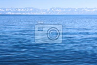 Постер Озеро Иссык-Куль Голубые горы, вид на озеро, Кыргызстан, Иссык-Куль.Озеро Иссык-Куль<br>Постер на холсте или бумаге. Любого нужного вам размера. В раме или без. Подвес в комплекте. Трехслойная надежная упаковка. Доставим в любую точку России. Вам осталось только повесить картину на стену!<br>