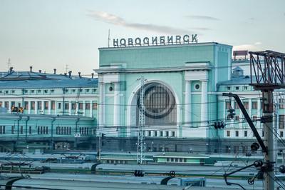 Постер Новосибирск Новосибирск железнодорожный вокзалНовосибирск<br>Постер на холсте или бумаге. Любого нужного вам размера. В раме или без. Подвес в комплекте. Трехслойная надежная упаковка. Доставим в любую точку России. Вам осталось только повесить картину на стену!<br>