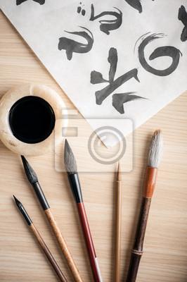 Постер-картина Иероглифы Крупным планом изображение инструменты каллиграфииИероглифы<br>Постер на холсте или бумаге. Любого нужного вам размера. В раме или без. Подвес в комплекте. Трехслойная надежная упаковка. Доставим в любую точку России. Вам осталось только повесить картину на стену!<br>