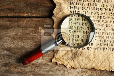 Постер-картина Иероглифы Гранж бумага с иероглифами с лупой на деревянных фонеИероглифы<br>Постер на холсте или бумаге. Любого нужного вам размера. В раме или без. Подвес в комплекте. Трехслойная надежная упаковка. Доставим в любую точку России. Вам осталось только повесить картину на стену!<br>