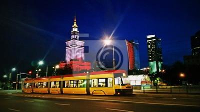 Постер-картина Трамваи Трамвай на Варшавской улице города в вечернее или ночное времяТрамваи<br>Постер на холсте или бумаге. Любого нужного вам размера. В раме или без. Подвес в комплекте. Трехслойная надежная упаковка. Доставим в любую точку России. Вам осталось только повесить картину на стену!<br>
