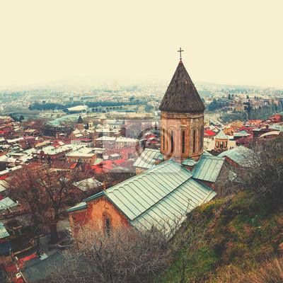 Постер Тбилиси Aerial view of Tbilisi, Georgia with beautiful churchТбилиси<br>Постер на холсте или бумаге. Любого нужного вам размера. В раме или без. Подвес в комплекте. Трехслойная надежная упаковка. Доставим в любую точку России. Вам осталось только повесить картину на стену!<br>
