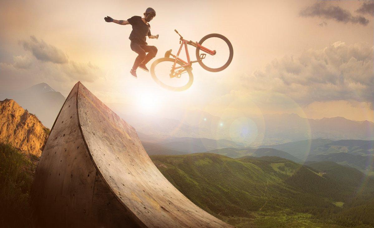 Постер-картина Велосипеды Спорт. Движения байкер прыгаетВелосипеды<br>Постер на холсте или бумаге. Любого нужного вам размера. В раме или без. Подвес в комплекте. Трехслойная надежная упаковка. Доставим в любую точку России. Вам осталось только повесить картину на стену!<br>