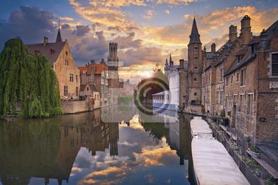 Брюгге. Изображения Брюгге, Бельгия во время красивый закат., 30x20 см, на бумагеБрюгге<br>Постер на холсте или бумаге. Любого нужного вам размера. В раме или без. Подвес в комплекте. Трехслойная надежная упаковка. Доставим в любую точку России. Вам осталось только повесить картину на стену!<br>