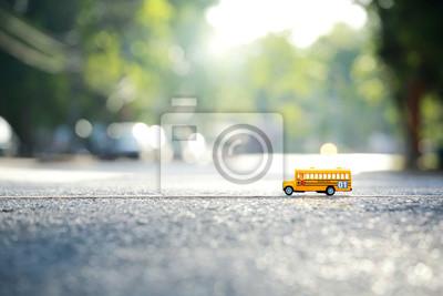 Постер-картина Автобусы, троллейбусы Желтый школьный автобус игрушка модель перекрестком.Малая глубина резкости композиция и днем происшествия.Автобусы, троллейбусы<br>Постер на холсте или бумаге. Любого нужного вам размера. В раме или без. Подвес в комплекте. Трехслойная надежная упаковка. Доставим в любую точку России. Вам осталось только повесить картину на стену!<br>