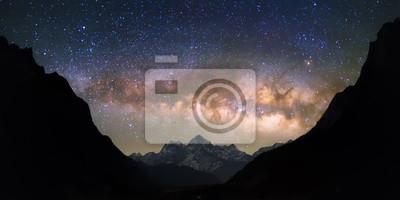 Постер Ночь Чаша небес. Светлые и яркие галактики Млечный Путь над заснеженными горами. Красивое звездное ночное небо, кажется, в чашу между холмами силуэт.Ночь<br>Постер на холсте или бумаге. Любого нужного вам размера. В раме или без. Подвес в комплекте. Трехслойная надежная упаковка. Доставим в любую точку России. Вам осталось только повесить картину на стену!<br>