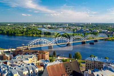 Постер Рига Железнодорожный мост через реку Даугава в РигеРига<br>Постер на холсте или бумаге. Любого нужного вам размера. В раме или без. Подвес в комплекте. Трехслойная надежная упаковка. Доставим в любую точку России. Вам осталось только повесить картину на стену!<br>
