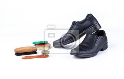 Постер Черные кожаные ботинки и польского оборудованияУход за обувью<br>Постер на холсте или бумаге. Любого нужного вам размера. В раме или без. Подвес в комплекте. Трехслойная надежная упаковка. Доставим в любую точку России. Вам осталось только повесить картину на стену!<br>