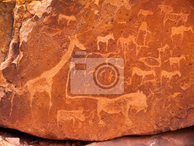 Постер Доисторические наскальные гравюры на Twyfelfontein в НамибииНаскальные рисунки<br>Постер на холсте или бумаге. Любого нужного вам размера. В раме или без. Подвес в комплекте. Трехслойная надежная упаковка. Доставим в любую точку России. Вам осталось только повесить картину на стену!<br>