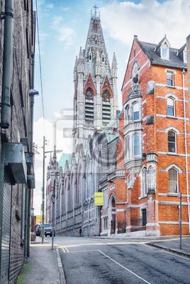 Постер Дублин Исторический центр Дублина, Церковь Джонс ЛейнДублин<br>Постер на холсте или бумаге. Любого нужного вам размера. В раме или без. Подвес в комплекте. Трехслойная надежная упаковка. Доставим в любую точку России. Вам осталось только повесить картину на стену!<br>