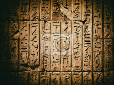Постер-картина Иероглифы Выветренные древние египетские боги, вырезанные в песчаникеИероглифы<br>Постер на холсте или бумаге. Любого нужного вам размера. В раме или без. Подвес в комплекте. Трехслойная надежная упаковка. Доставим в любую точку России. Вам осталось только повесить картину на стену!<br>
