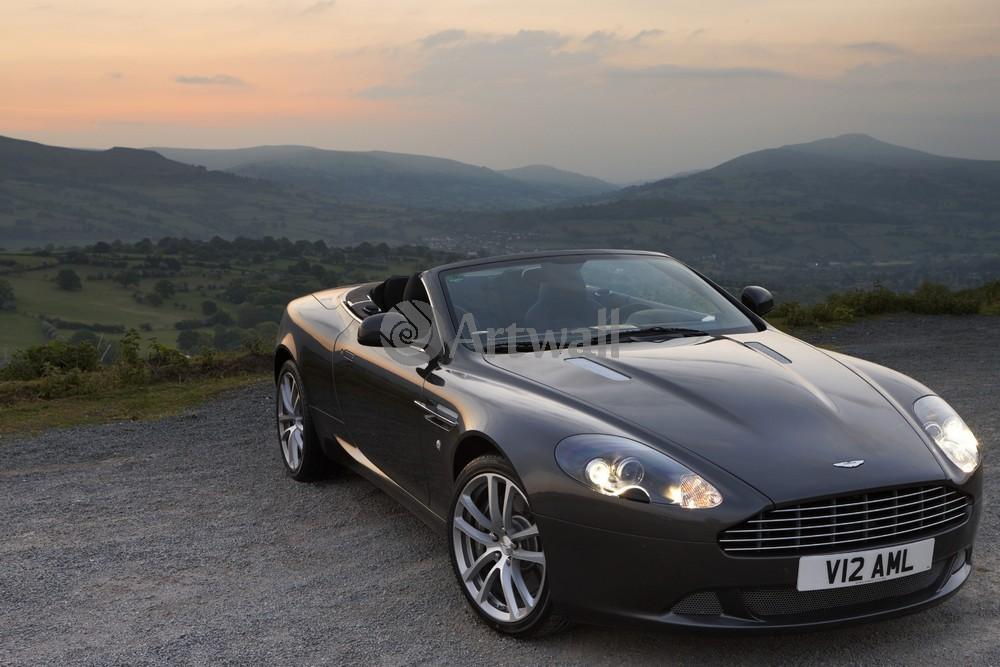 Постер Aston Martin DB9 Volante, 30x20 см, на бумагеDB9 Volante<br>Постер на холсте или бумаге. Любого нужного вам размера. В раме или без. Подвес в комплекте. Трехслойная надежная упаковка. Доставим в любую точку России. Вам осталось только повесить картину на стену!<br>
