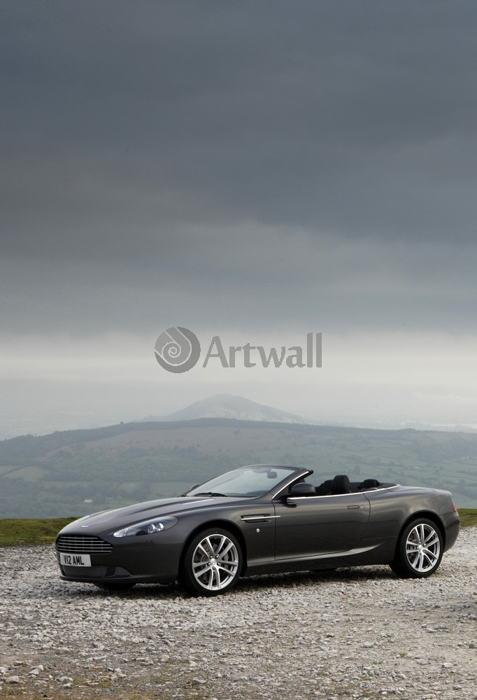 Постер Aston Martin DB9 Volante, 20x29 см, на бумагеDB9 Volante<br>Постер на холсте или бумаге. Любого нужного вам размера. В раме или без. Подвес в комплекте. Трехслойная надежная упаковка. Доставим в любую точку России. Вам осталось только повесить картину на стену!<br>