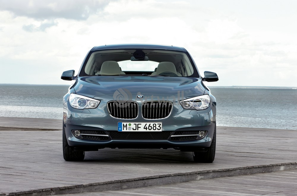 Постер BMW 5 GT, 30x20 см, на бумаге5 GT<br>Постер на холсте или бумаге. Любого нужного вам размера. В раме или без. Подвес в комплекте. Трехслойная надежная упаковка. Доставим в любую точку России. Вам осталось только повесить картину на стену!<br>