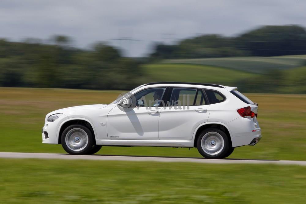 Постер BMW X1, 30x20 см, на бумагеX1<br>Постер на холсте или бумаге. Любого нужного вам размера. В раме или без. Подвес в комплекте. Трехслойная надежная упаковка. Доставим в любую точку России. Вам осталось только повесить картину на стену!<br>