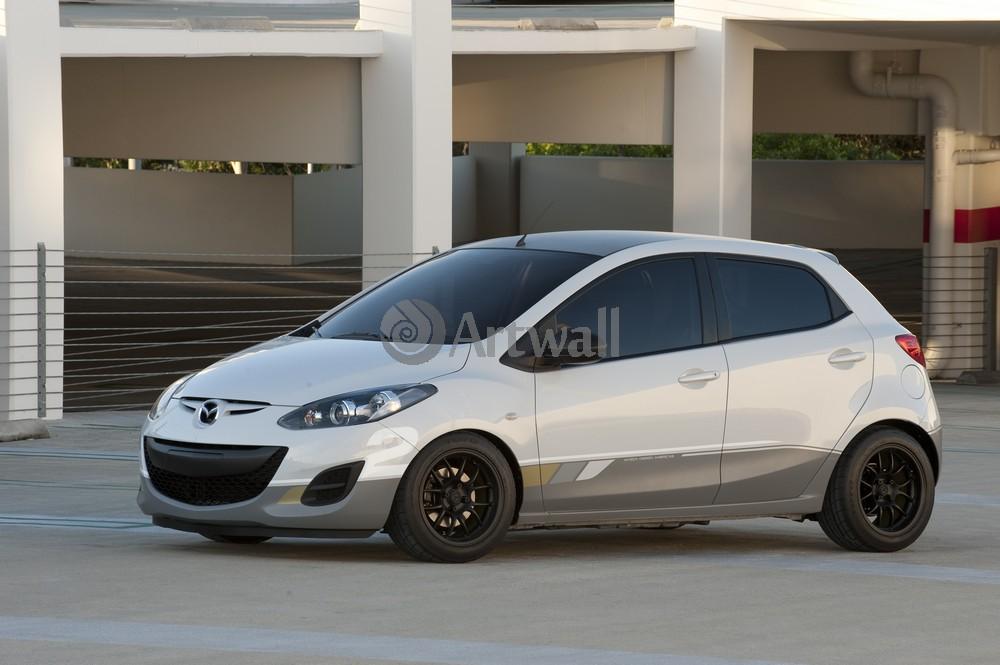 Постер Mazda 2, 30x20 см, на бумаге2<br>Постер на холсте или бумаге. Любого нужного вам размера. В раме или без. Подвес в комплекте. Трехслойная надежная упаковка. Доставим в любую точку России. Вам осталось только повесить картину на стену!<br>