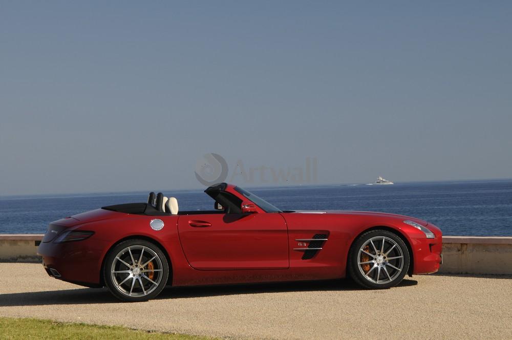 Постер Mercedes-Benz SLS AMG Roadster, 30x20 см, на бумагеSLS AMG Roadster<br>Постер на холсте или бумаге. Любого нужного вам размера. В раме или без. Подвес в комплекте. Трехслойная надежная упаковка. Доставим в любую точку России. Вам осталось только повесить картину на стену!<br>