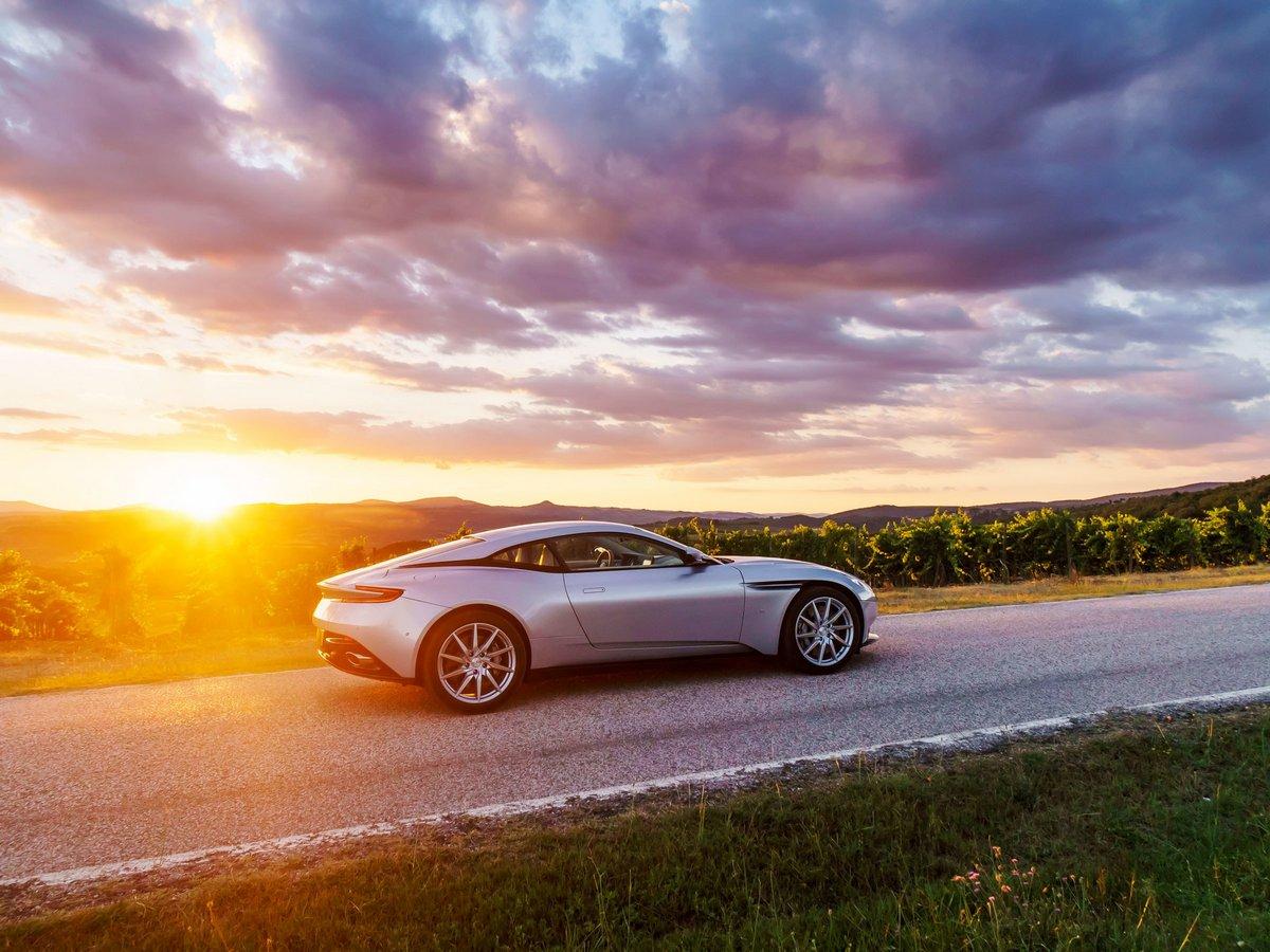 Постер Aston Martin DB11 (2016), 27x20 см, на бумагеDB11<br>Постер на холсте или бумаге. Любого нужного вам размера. В раме или без. Подвес в комплекте. Трехслойная надежная упаковка. Доставим в любую точку России. Вам осталось только повесить картину на стену!<br>