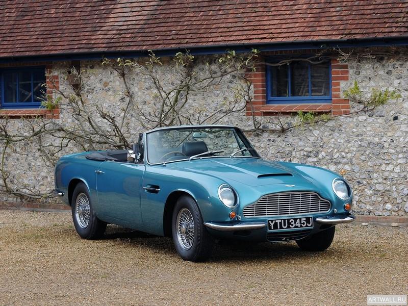 Постер Aston Martin DB6 Volante 1966-69, 27x20 см, на бумагеAston Martin<br>Постер на холсте или бумаге. Любого нужного вам размера. В раме или без. Подвес в комплекте. Трехслойная надежная упаковка. Доставим в любую точку России. Вам осталось только повесить картину на стену!<br>
