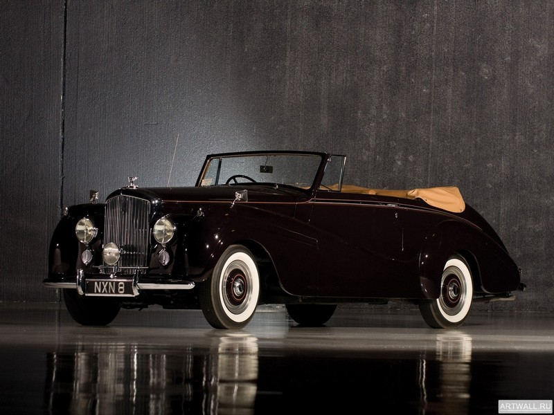 Постер Bentley R-Type Drophead Coupe Park Ward 1953, 27x20 см, на бумагеBentley<br>Постер на холсте или бумаге. Любого нужного вам размера. В раме или без. Подвес в комплекте. Трехслойная надежная упаковка. Доставим в любую точку России. Вам осталось только повесить картину на стену!<br>