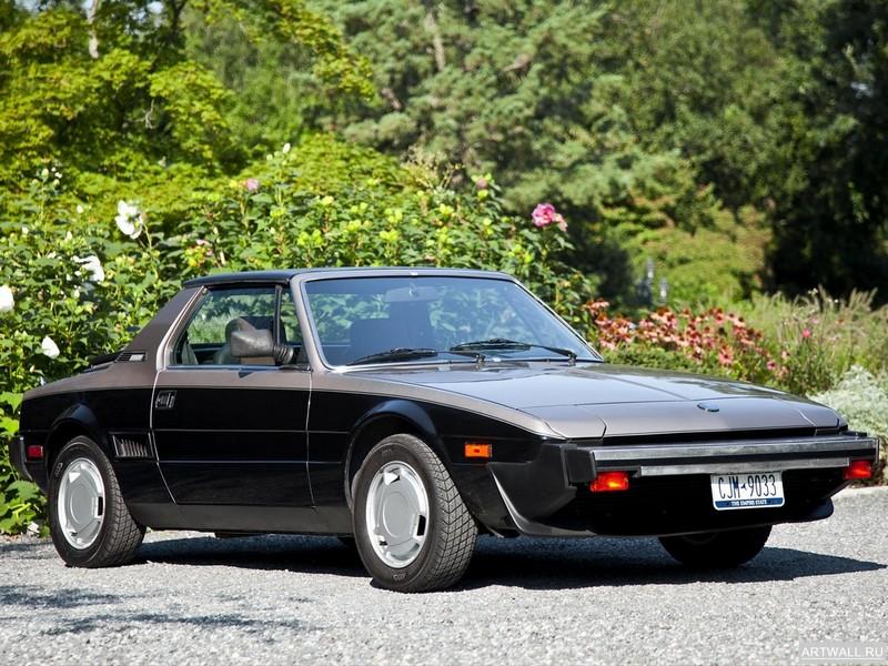 Постер Bertone X1 9 US-spec (128) 1982-87 дизайн Bertone, 27x20 см, на бумагеРазные марки<br>Постер на холсте или бумаге. Любого нужного вам размера. В раме или без. Подвес в комплекте. Трехслойная надежная упаковка. Доставим в любую точку России. Вам осталось только повесить картину на стену!<br>