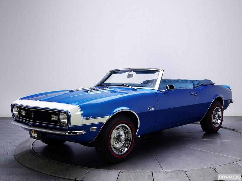 Постер Chevrolet Camaro 327 Convertible 1968, 27x20 см, на бумагеChevrolet<br>Постер на холсте или бумаге. Любого нужного вам размера. В раме или без. Подвес в комплекте. Трехслойная надежная упаковка. Доставим в любую точку России. Вам осталось только повесить картину на стену!<br>