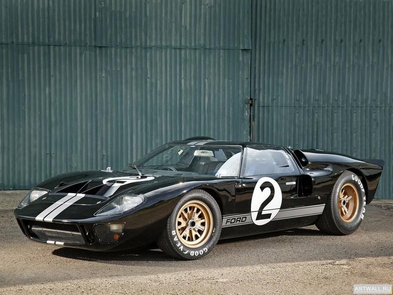 Постер Ford GT40 Le Mans Race Car 1966, 27x20 см, на бумагеFord<br>Постер на холсте или бумаге. Любого нужного вам размера. В раме или без. Подвес в комплекте. Трехслойная надежная упаковка. Доставим в любую точку России. Вам осталось только повесить картину на стену!<br>