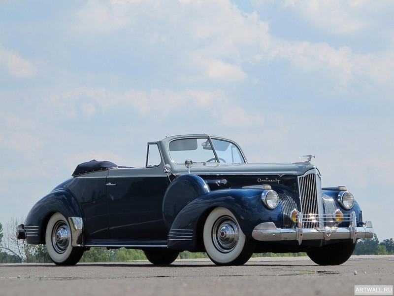 Постер Packard 120 Convertible Coupe 1941, 27x20 см, на бумагеPackard<br>Постер на холсте или бумаге. Любого нужного вам размера. В раме или без. Подвес в комплекте. Трехслойная надежная упаковка. Доставим в любую точку России. Вам осталось только повесить картину на стену!<br>